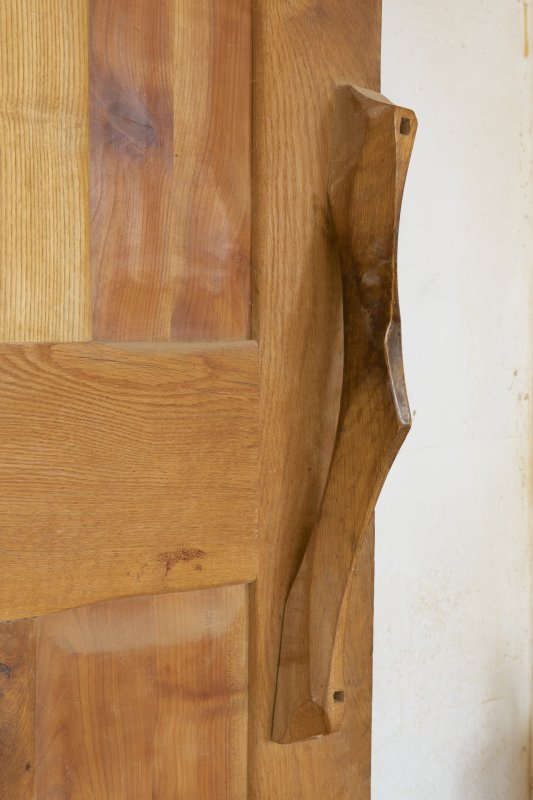 Interior view showing detail of door handle to varnishing room in stables workshop at The Steading, Nether Blainslie.
