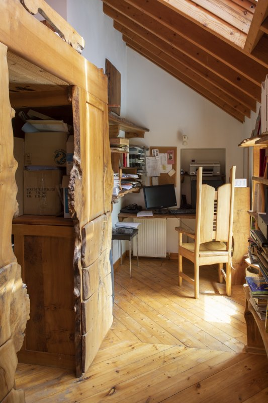 Interior view showing raised bed above wardrobe and storage in Bedroom Two on first floor of house at The Steading, Nether Blainslie.