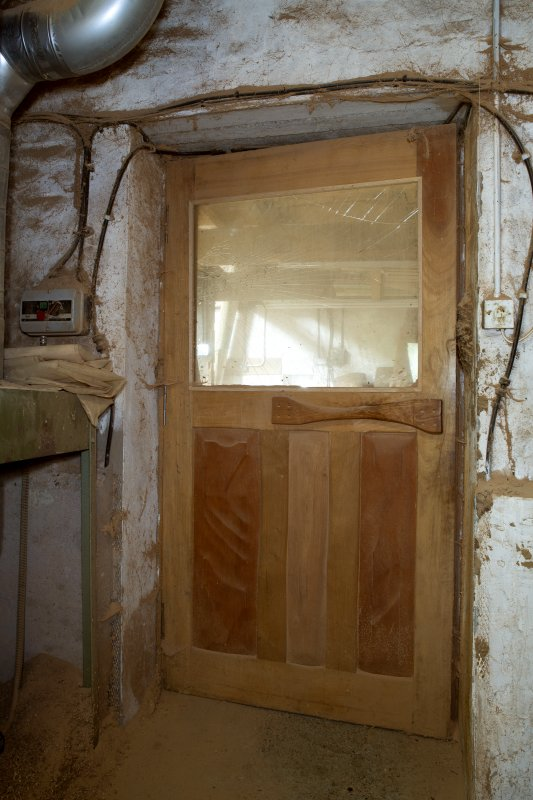 Interior view showing door of workshop at The Steading, Nether Blainslie.