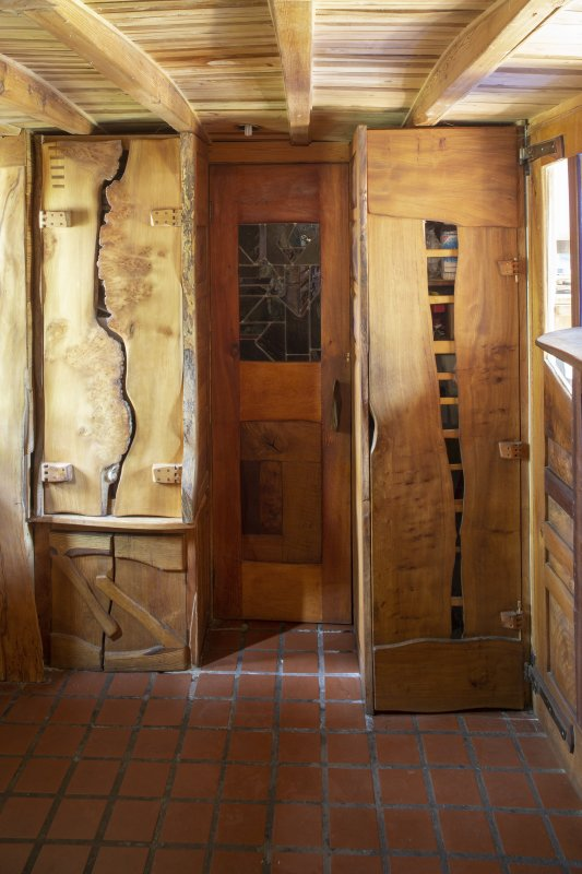 Interior view showing door designs in ground-floor entrance lobby of house at The Steading, Nether Blainslie.