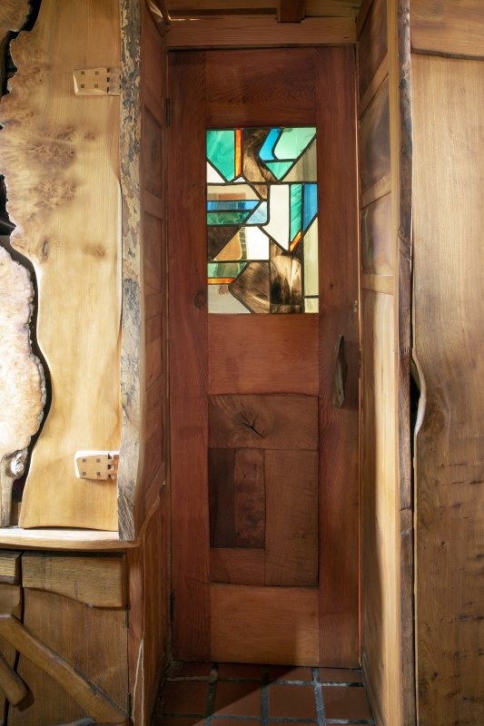 Interior view showing door with stained glass in ground-floor entrance lobby of house at The Steading, Nether Blainslie.