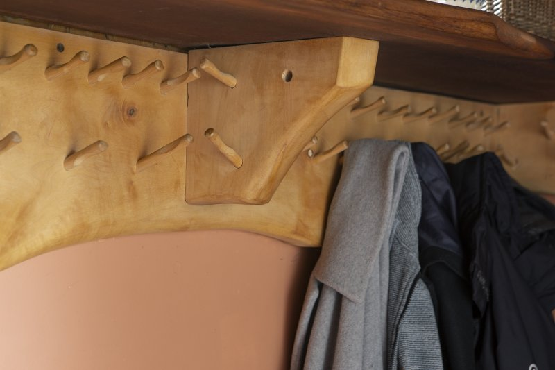 Interior view showing detail of coat hooks in ground-floor entrance lobby of house at The Steading, Nether Blainslie.