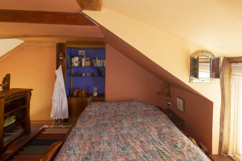 Interior view of 'hayloft' bedroom in ground-floor study of house at The Steading, Nether Blainslie.