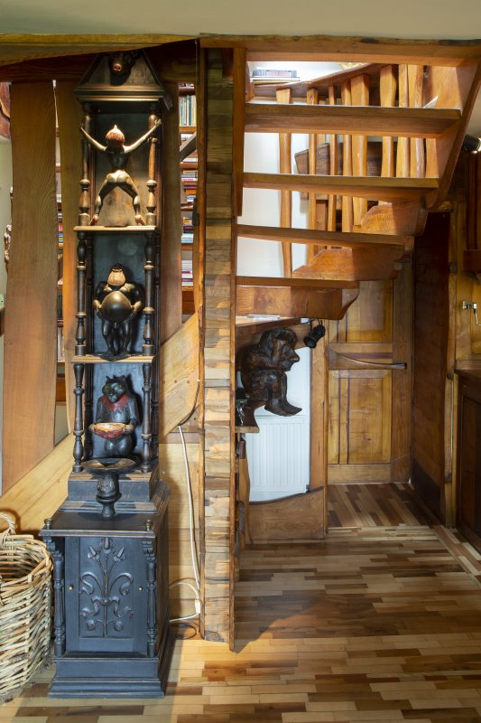 Interior view showing sculpture beside staircase from ground floor in house at The Steading, Nether Blainslie.