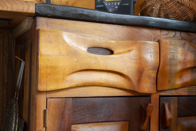 Interior view showing detail of drawer fronts in kitchen on ground floor of house at The Steading, Nether Blainslie.