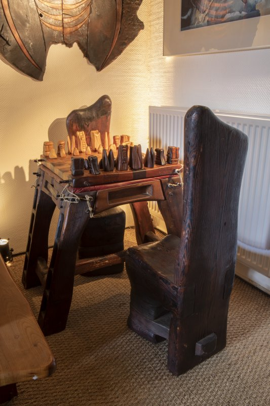 Interior view showing chess board (first piece made by Tim Stead) in living room on ground floor of house at The Steading, Nether Blainslie.