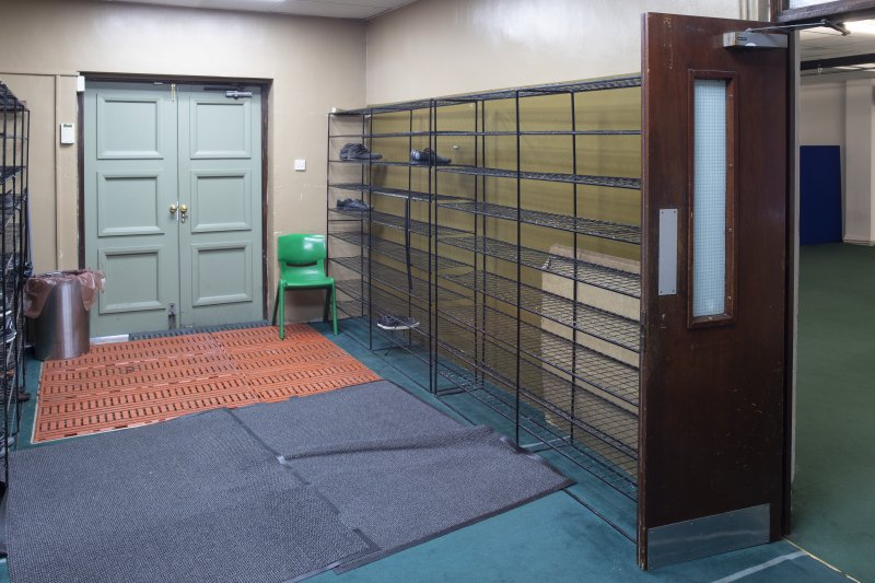 Interior view showing ground-floor entrance hallway with shoe racks, from south-east, in Mosque, Forth Street, Glasgow.