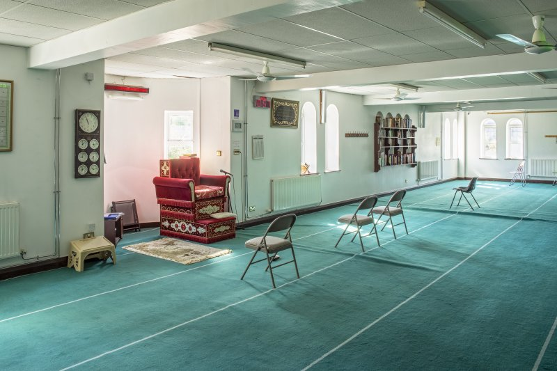 Interior view showing ground-floor prayer hall from north, in Mosque, Forth Street, Glasgow.