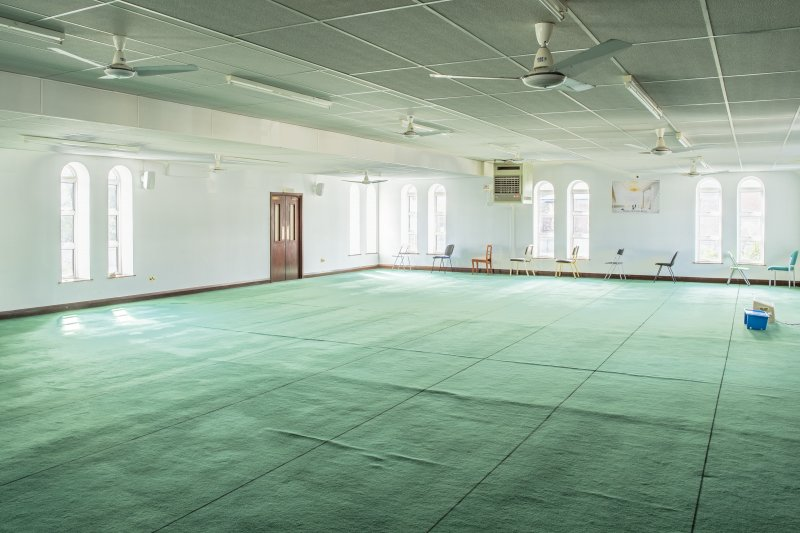 Interior view showing first-floor prayer hall from north-west, in Mosque, Forth Street, Glasgow.