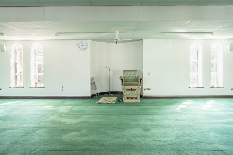 Interior view showing first-floor prayer hall from west, featuring mihrab and minbar, in Mosque, Forth Street, Glasgow.