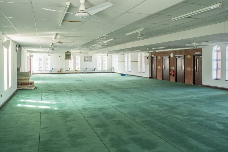 Interior view showing first-floor prayer hall from north, in Mosque, Forth Street, Glasgow.