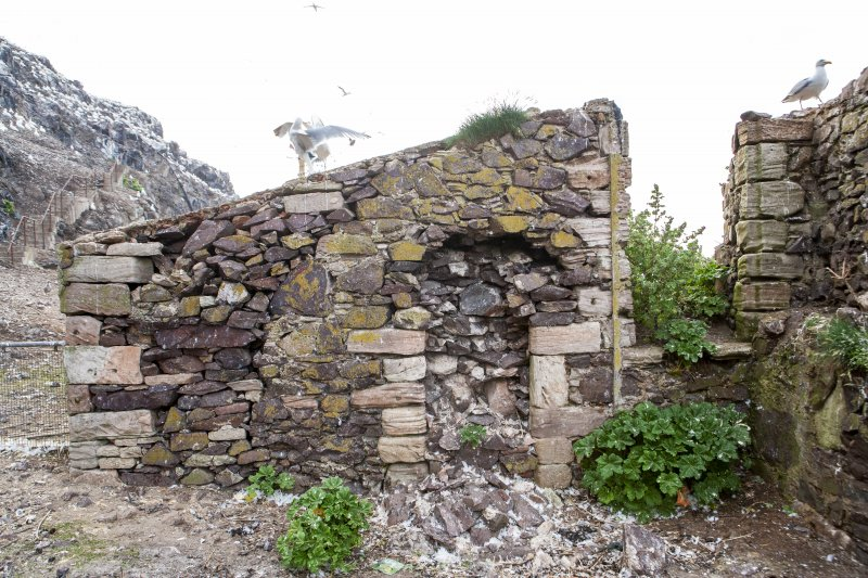 Detail of interior castle wall and fireplace.
