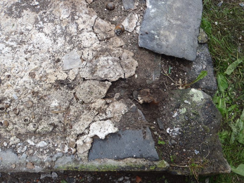 Archaeological works, Stone 1, close up of plinth with plaque removed showing human mandible and teeth, St Columba's Chapel, Aiginis, Isle of Lewis
