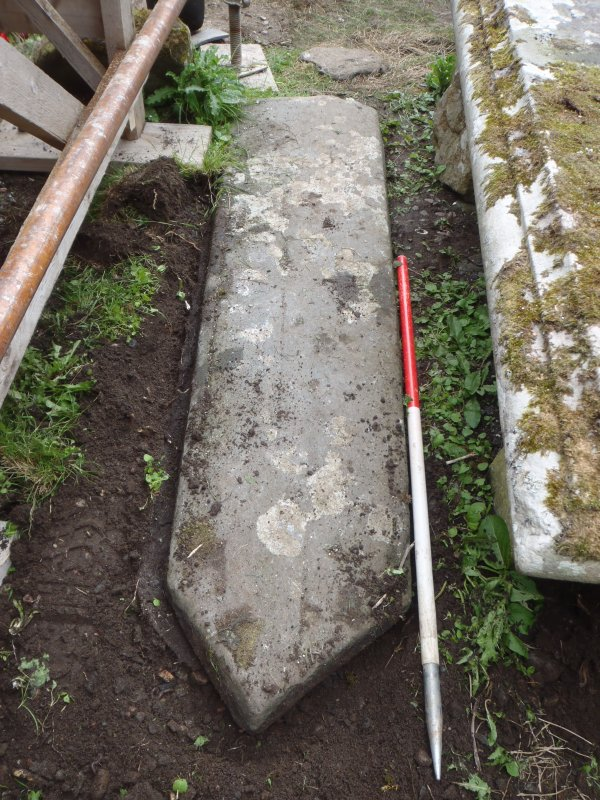 Archaeological works, Stone 3 with slot excavated around circumference, St Columba's Chapel, Aiginis, Isle of Lewis