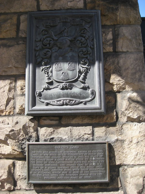 Detail of plaque giving history of site of former Golfer's Land, 79-81 Canongate, Edinburgh.