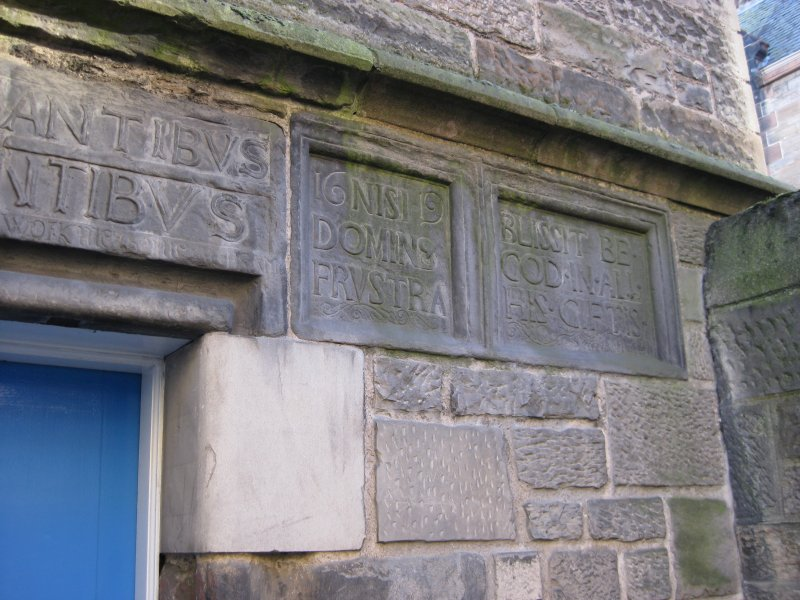 Detail of carved stones beside doorway to No 84 Canongate, Nisbet of Dirleton's House, 82-4 Canongate, Edinburgh.