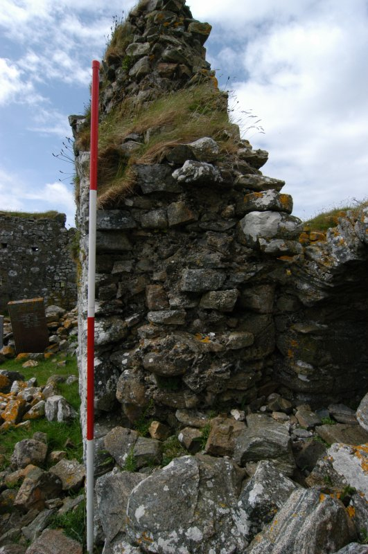 Historic building survey, Church interior, E facing section through the wall showing core work, Teampull na Trionaid, Cairinis, North Uist, Western Isles