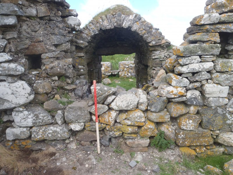 Excavation, Entrance into McVicar chapel prior to removal of blocking stones, Teampull na Trionaid, Cairinis, North Uist, Western Isles