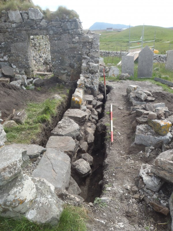 Excavation, Trench 2, post-excavation, oblique shot of S-facing section of wall 004, Teampull na Trionaid, Cairinis, North Uist, Western Isles