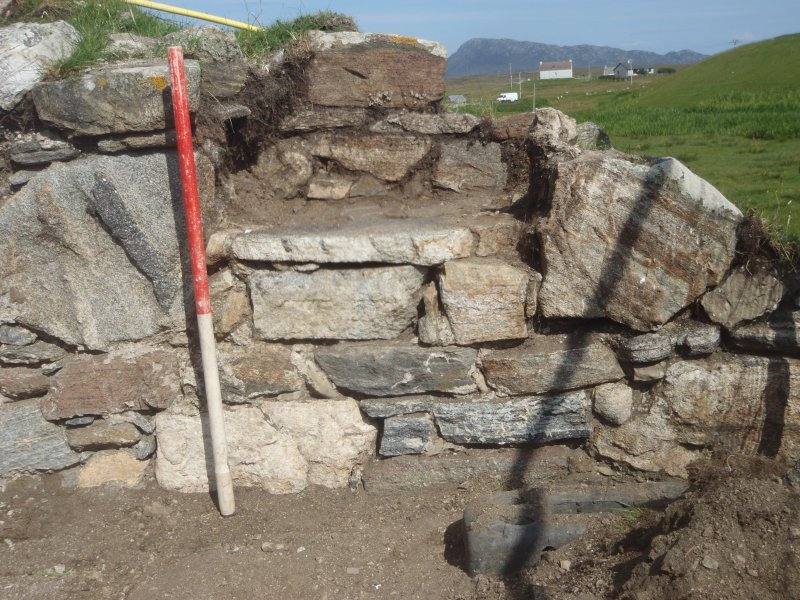 Excavation, E wall of main church following removal of skull, Teampull na Trionaid, Cairinis, North Uist, Western Isles