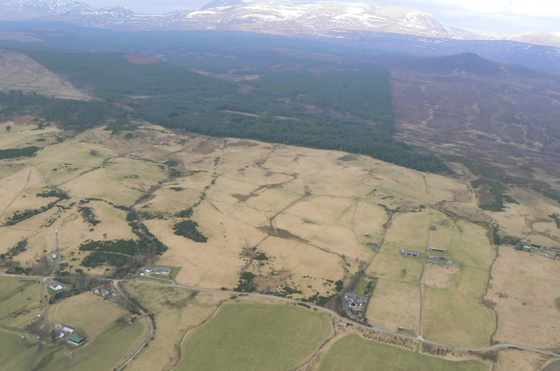 Oblique aerial view, looking NNW over the Heights of Fodderty in the foreground towards Ben Wyvis, near Dingwall.