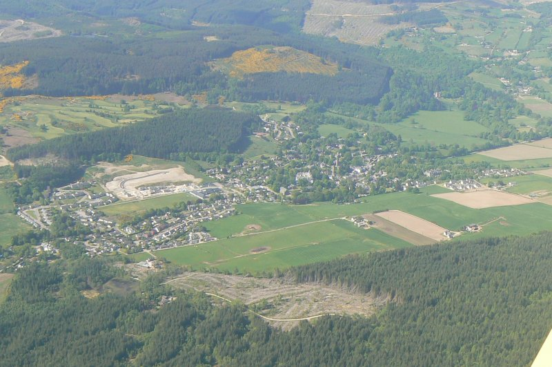 A distant oblique aerial view of Strathpeffer, Easter Ross, looking NE.
