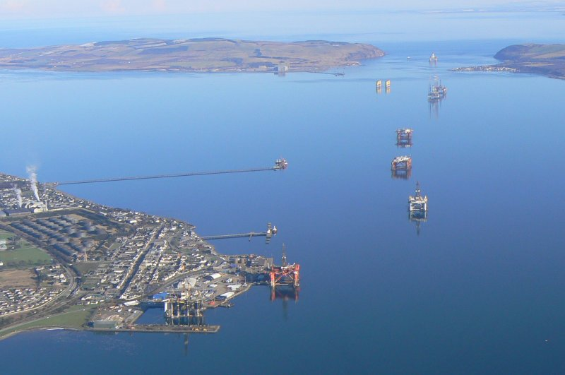 Aerial view of Invergordon, harbour, oil tanks and oil rigs, near Dingwall, Easter Ross, looking E.