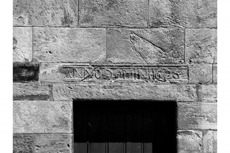 South facade, west doorway, detail of 1626 datestone lintel