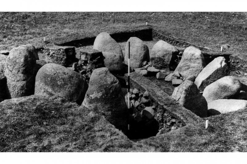 Excavation photograph - boulder kerb with cairn material removed.