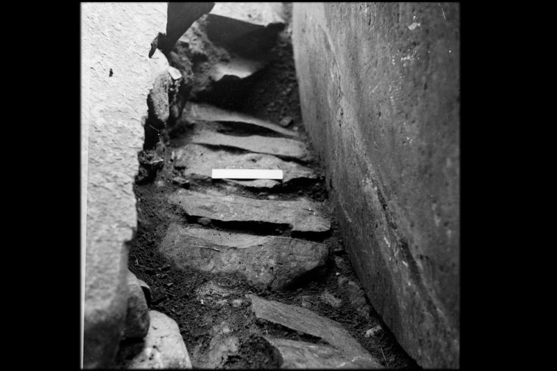 Excavation photographs - paving in chamber and passage, from the north-west.