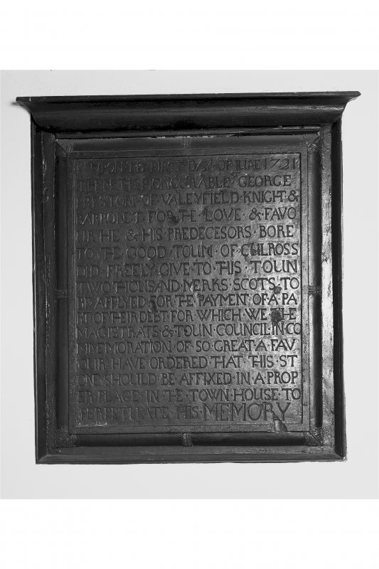 First Floor, east room, detail of carved stone commemorative plaque.