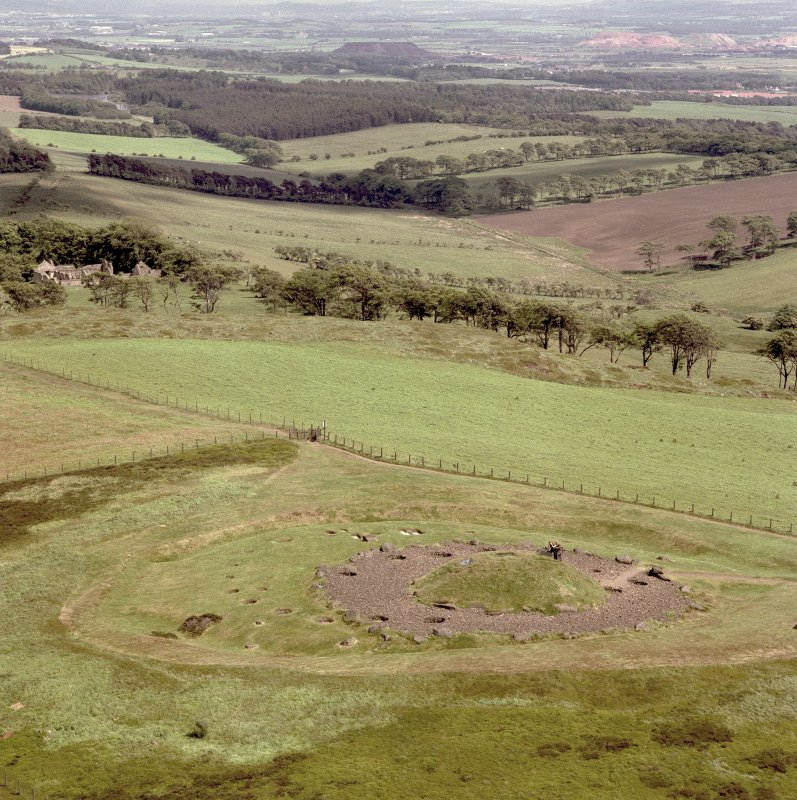 Oblique aerial view centred on the remains of Cairnpapple henge and cairn