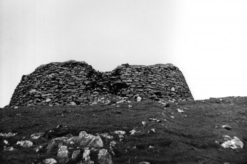 View looking upslope from the SE towards the external wall of the broch.