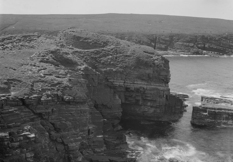 View across cliffs to the Broch of Borwick.  Glass negative.
