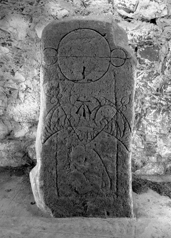 North face of symbol stone showing triple-disc and bar above a crescent and V-rod.