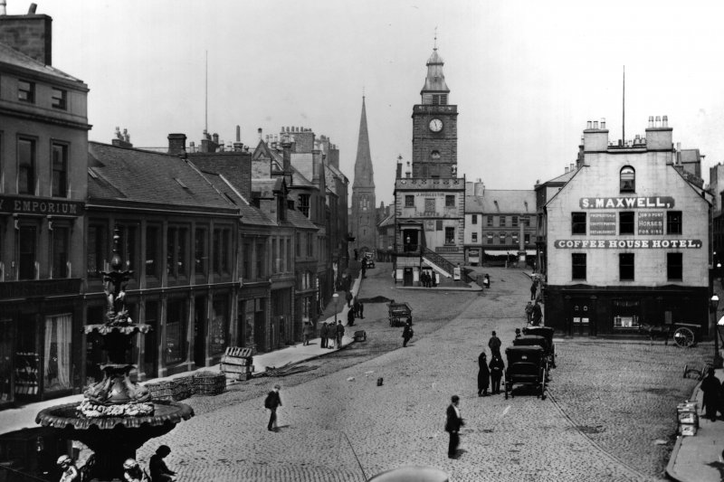 Photographic copy of historic photograph showing general view from south of Dumfries High Street including Midsteeple.