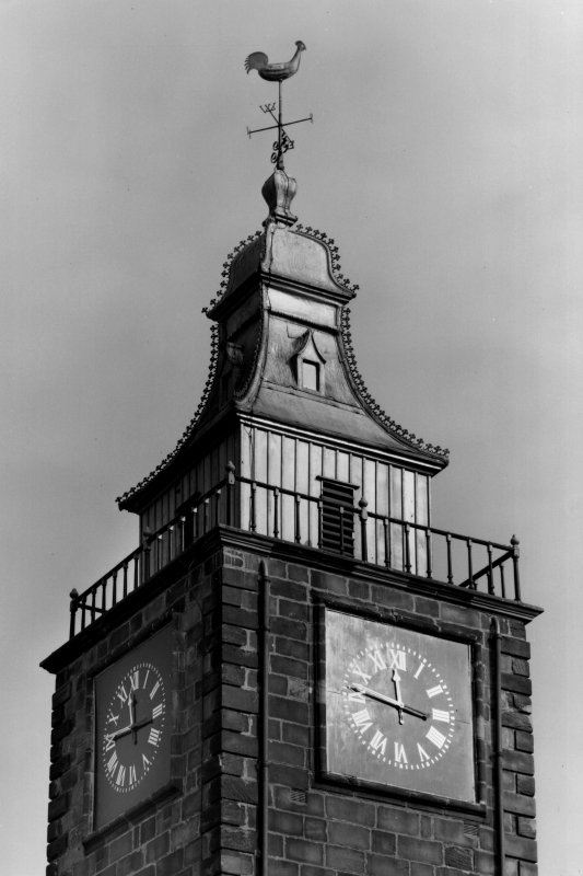 Detail of steeple crown, weather vane and clock following restoration the previous year (1958).