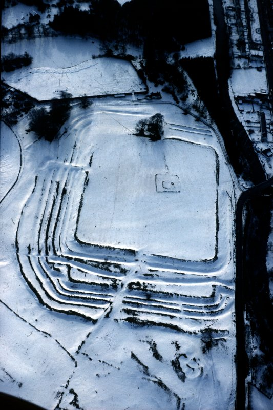 Oblique aerial view of Ardoch Roman Fort in the snow.