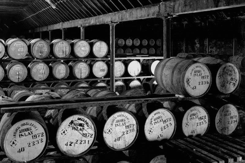 Ardbeg Distillery. Interior of bonded warehouse showing traditional method of stacking casks.