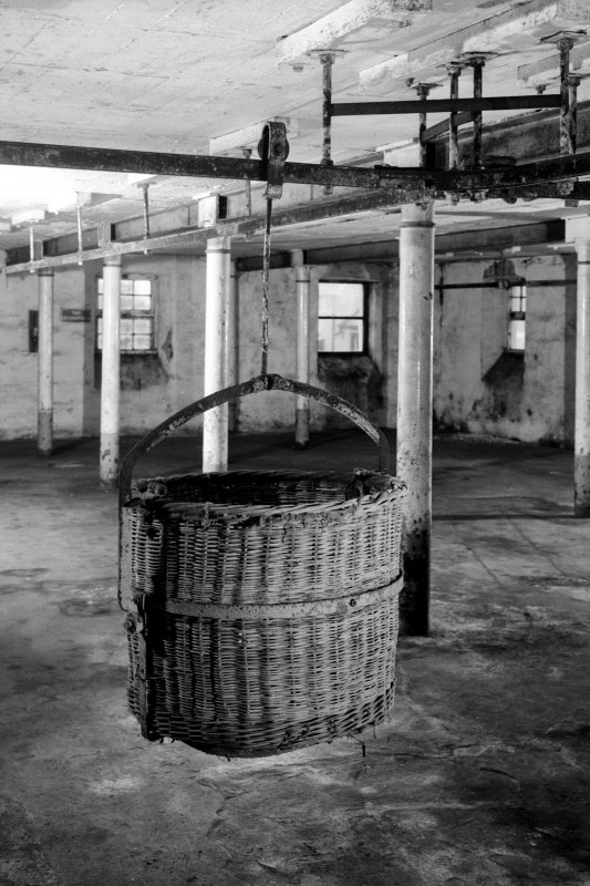 Lagavulin Distillery, Old Malt Barn. Interior view showing mono-rail wicker-basket system (travellers) for conveying steeped barley from steeps on to malting floor.