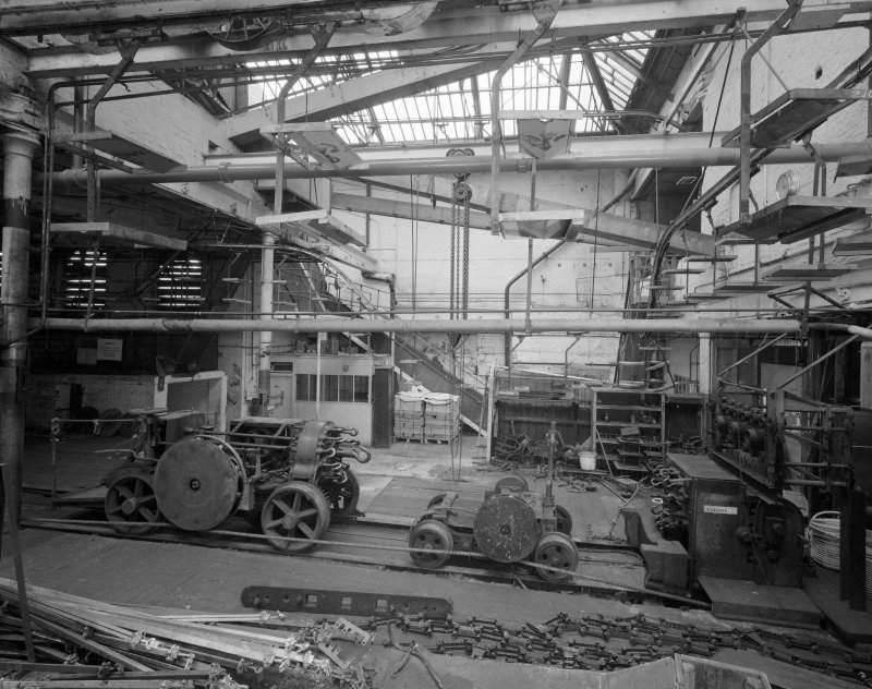 Interior view of East end of ropewalk showing three-part relationship of walk machinery: foregear, traveller and top-cart (reading from right to left).