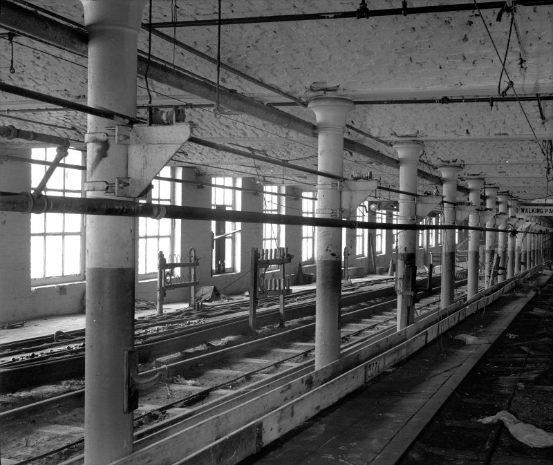 Interior view of intermediate two-storey section - arched fireproof floor construction supported on centre row of cast-iron columns