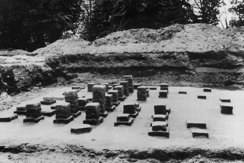 Excavation photograph: the hypocaust, at W end, looking S.