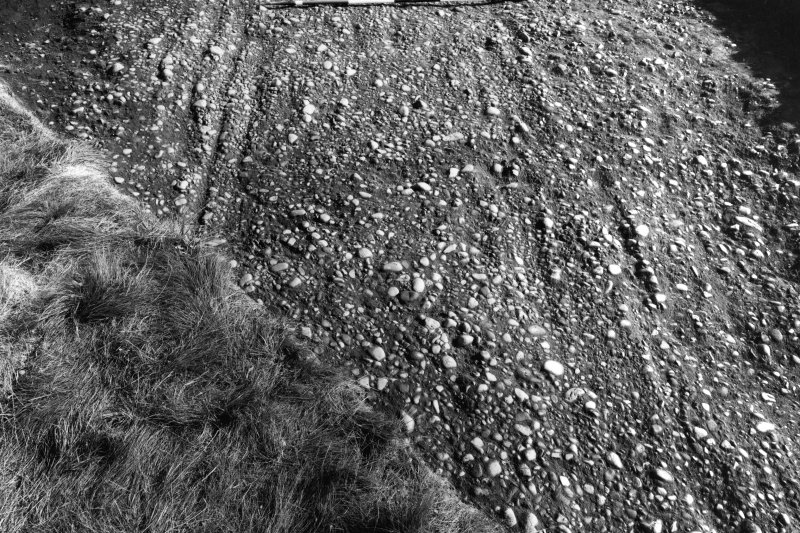 Excavation photograph:the rutted surface of Via Quintana, S of fabrica, seen from W.