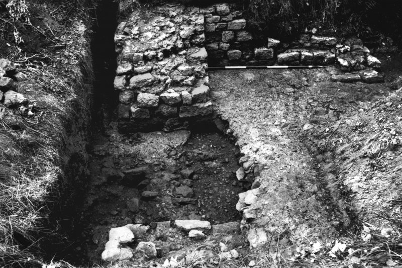 Excavation photograph showing the E wall at the NE angle, from the fort.