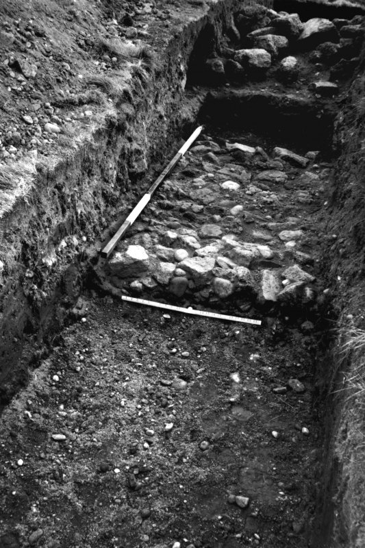 Excavation photograph showing the E wall and rampart, looking E.