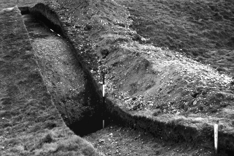 Excavation photograph showing the E defences, ditch and upcast mound.