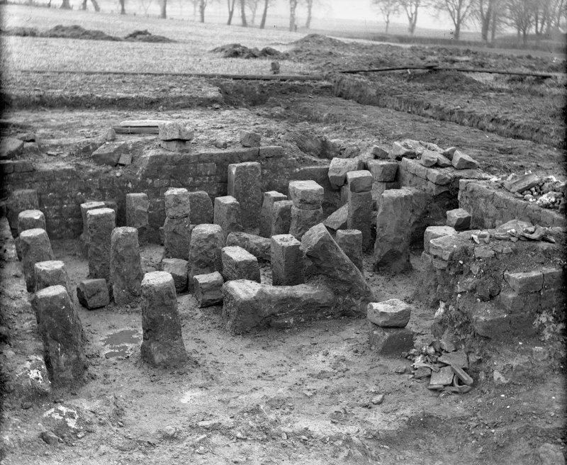 Excavation photograph. Hypocaust pillars beneath room 15 of Praetorium.   Duplicate print (C 30084) from A O Curle album (MS/28/461) is titled 'Western Hypocaust from SE'.