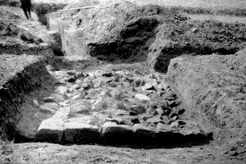 Excavation photograph. Foundations at S end of Castle Tower lying over N and  S ditch and parallel to the E and W ditch. Copied from A O Curle photograph album MS/28/461. Duplicate of ST/1859.