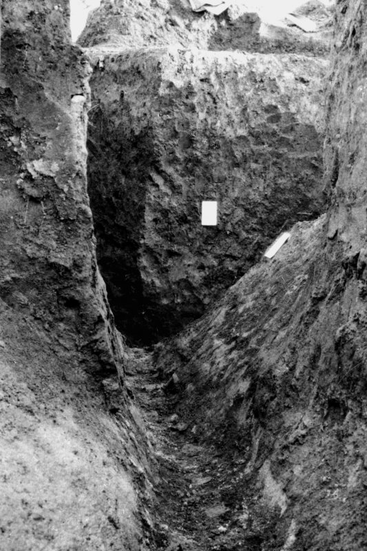 Excavation photograph. Outer Antonine ditch. Copied from A O Curle photograph album MS/28/461. Duplicate of ST/1921.